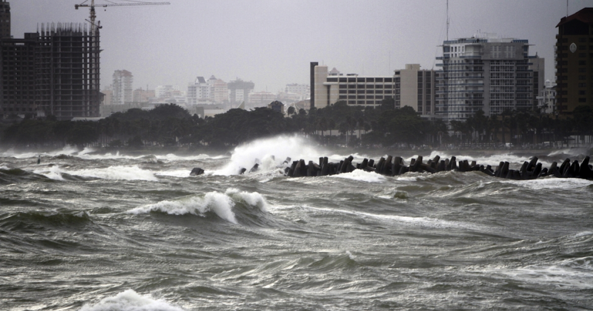 Raging waves batter against the shore in the seafront in Santo Domingo, Dominican Republic, on August 23, 2011, after the passage of Hurricane Irene. Forecasters warned that the category 3 hurricane could strengthen as it blows through the Bahamas and approaches North Carolina on the U.S. mainland.</p>