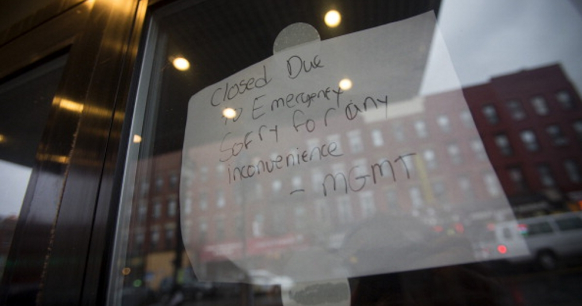 A sign that reads 'Closed due to Emergency' hangs in the window of a Starbucks Corp. coffee shop in New York, U.S., on Monday, Oct. 29, 2012. Hurricane Sandy strengthened on its path toward New Jersey, where it is predicted to make landfall today while bringing a life-threatening storm surge as it whips a region of 60 million people with high winds and rain.</p>