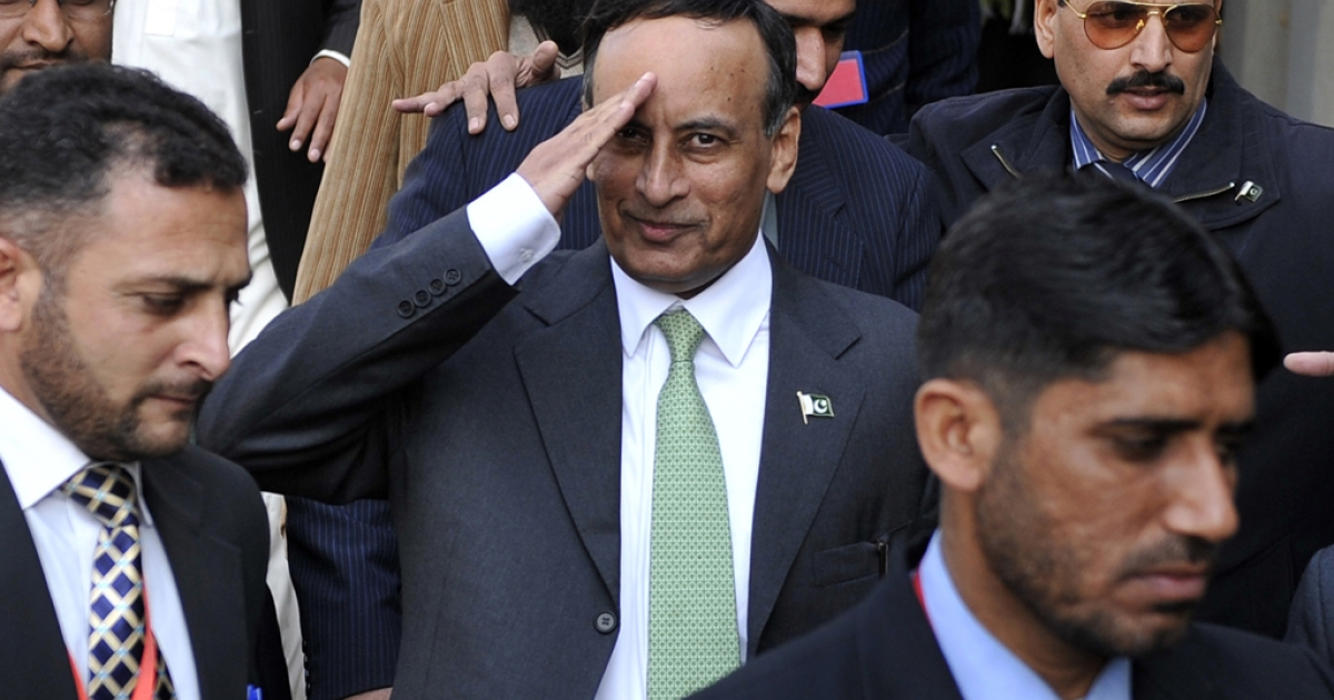Pakistan's former ambassador to United States Husain Haqqani (C) gestures as he leaves The High Court Building in Islamabad on January 9, 2012. The judicial commission probing a secret memo scandal found on June 12, 2012, that Haqqani allegedly approached the US authorities to prevent a possible coup d'etat by the powerful military. Haqqani could face treason charges.</p>