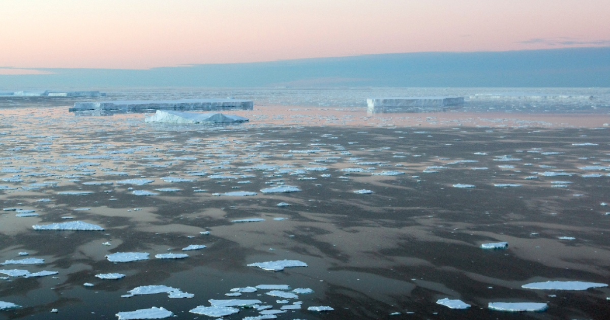 Giant tabular icebergs are surrounded by ice floe drift in Vincennes Bay on January 11, 2008 in the Australian Antarctic Territory.</p>
