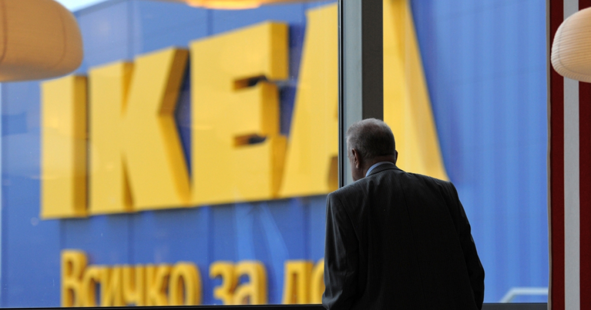 A man looks through a window of an Ikea store in Sofia. Ikea, the world's biggest home-furnishing retailer, plans to invest $1.9 billion in India, opening 25 stores in Asia's third largest economy.</p>