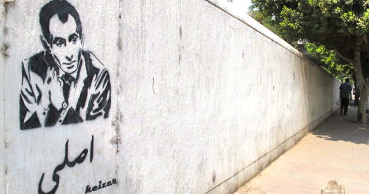 Well-known for his bold, hard-hitting journalism, Yosri Fouda's graffitied face appears all over Cairo, reading