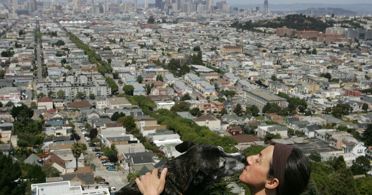 Christine Ponelle gets a kiss from her dog Cholla at Bernal Heights Park May 2, 2007 in San Francisco, California.</p>