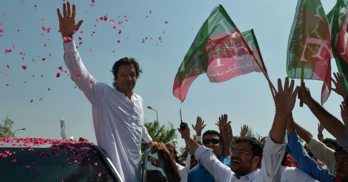 Pakistan cricketer turned politician Imran Khan waves to supporters at the start of a rally on the outskirts of Islamabad on October 6, 2012. Khan is leading western peace activists and local loyalists on a highly publicized march to Pakistan's tribal belt in protest against US drone strikes.</p>