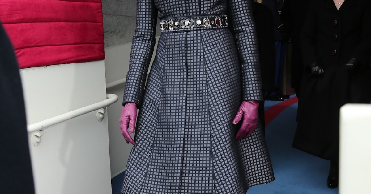 First lady Michelle Obama, wearing a navy-and-black checkered Thom Browne coat, a dress by the same New York designer, and a cardigan by Reed Krakoff to the Inauguration. The look was finished off with a J. Crew belt and black Reed Krakoff boots.</p>