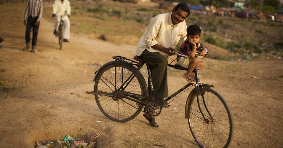 A father with his son in a shanty village in Faridabad, India.</p>