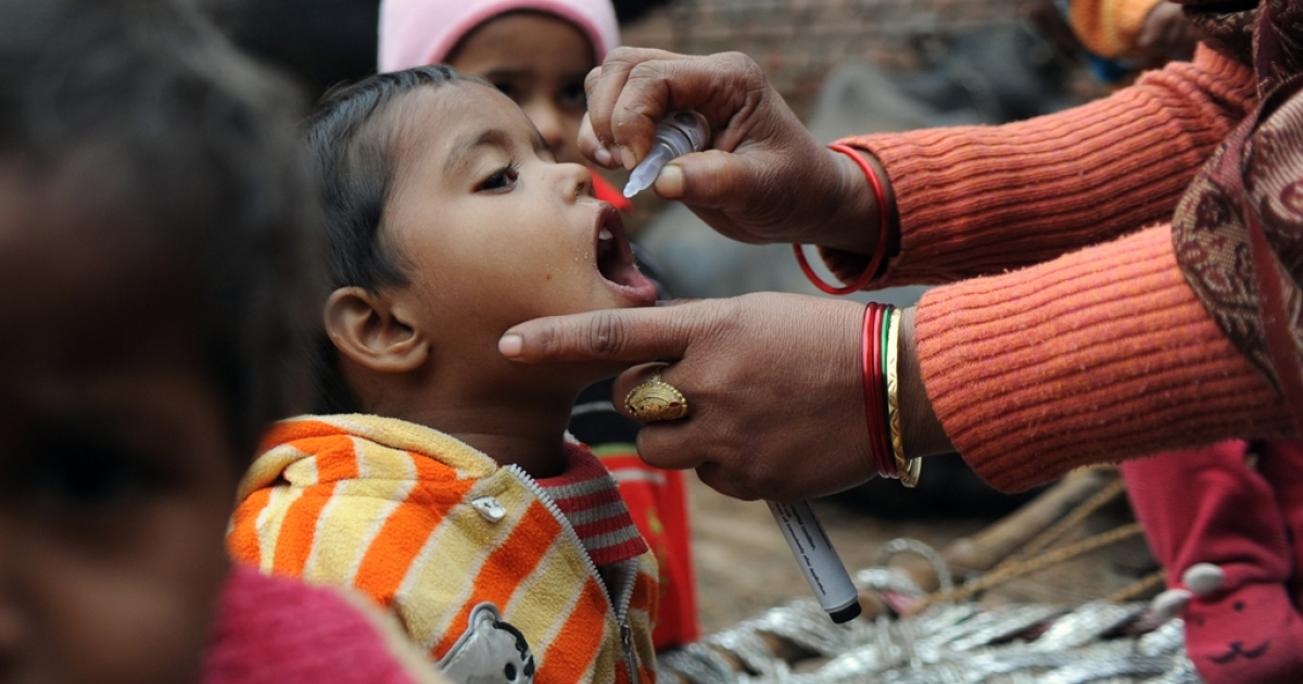 A health worker gives a child polio drops on the outskirts of New Delhi, Jan. 17, 2012.</p>
