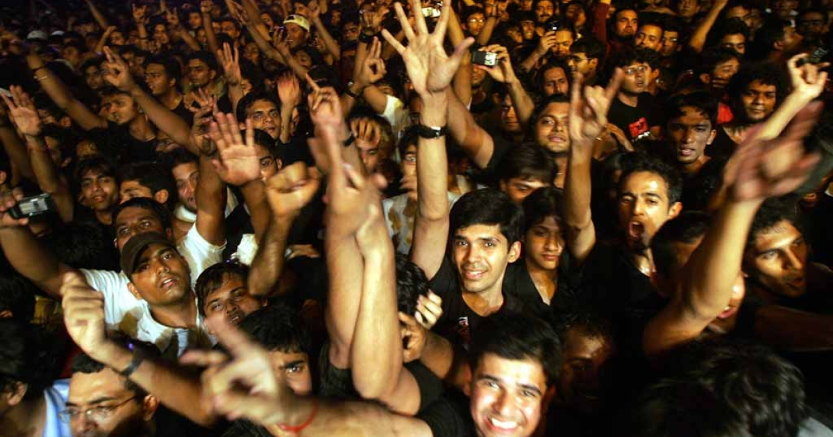 Indian fans of British rock group Iron Maiden shout as their heroes perform during a concert in Bangalore.</p>