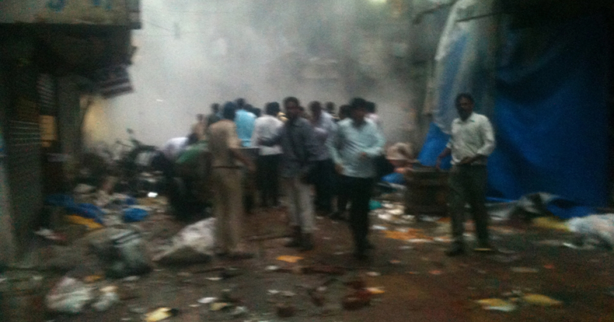 This picture posted on Twitter shows people at the scene of a bomb blast moments after the explosion at Zaveri bazar in Mumbai on July 13, 2011.</p>