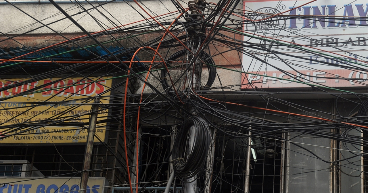 An electric pole in Kolkata on July 31, 2012.</p>