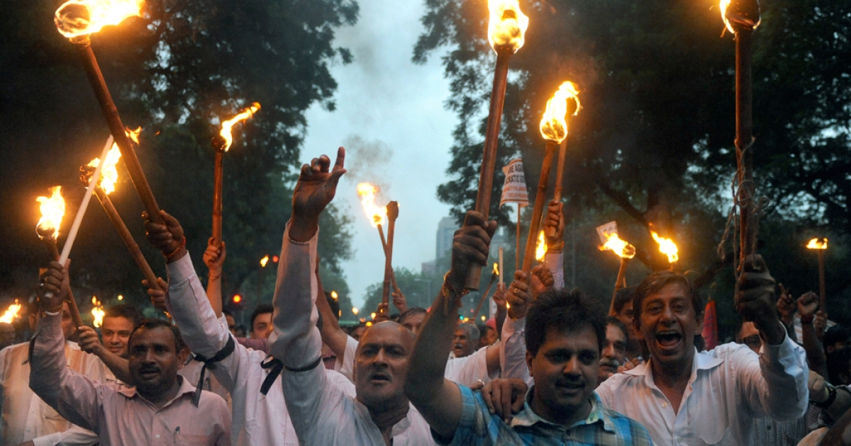 Activists from India's main opposition Bharatiya Janata Party (BJP) hold lighted torches and candles during a protest march in New Delhi on August 16, 2011, against the arrest of  Indian social activist Anna Hazare.</p>