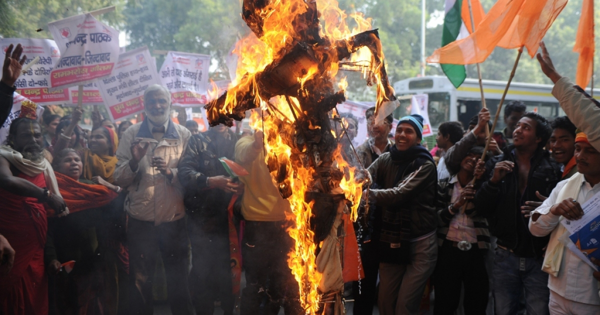 Indian protesters burn a rapist in effigy Dec. 26, 2012, in New Delhi, India.</p>