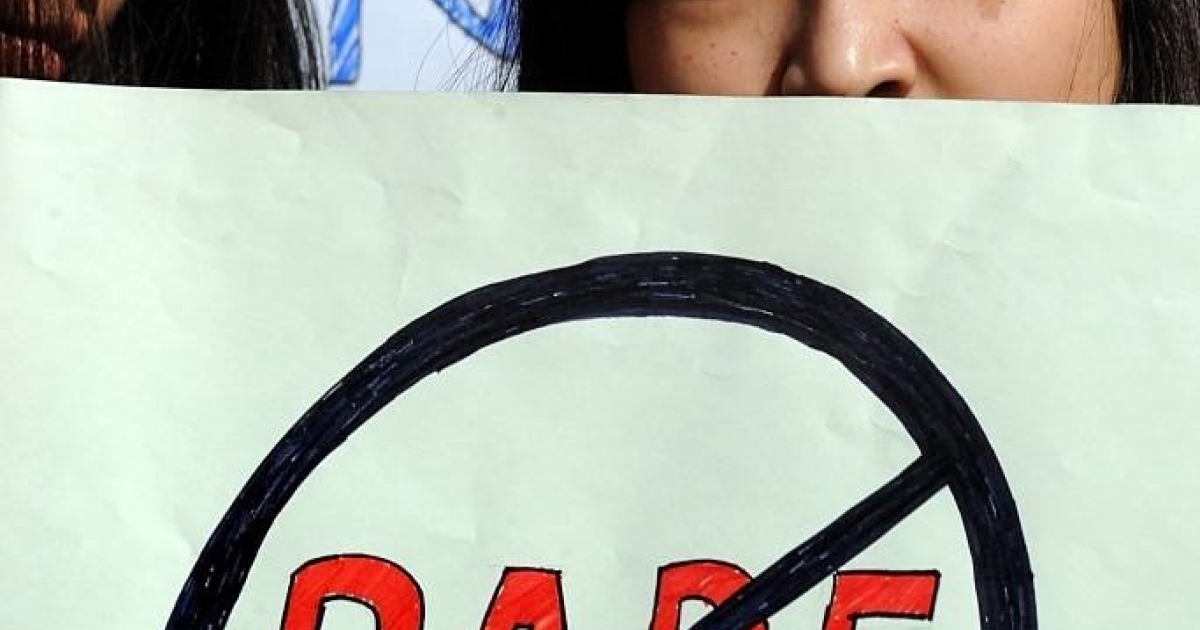 Women from India's North Eastern states hold placards during a peaceful protest against the rape of a girl from Mizoram, in New Delhi on November 29, 2010.</p>