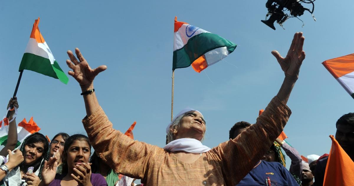 Supporters of Indian social activist Anna Hazare gesture at the venue of Hazare's fast in Mumbai on Dec. 28, 2011.</p>