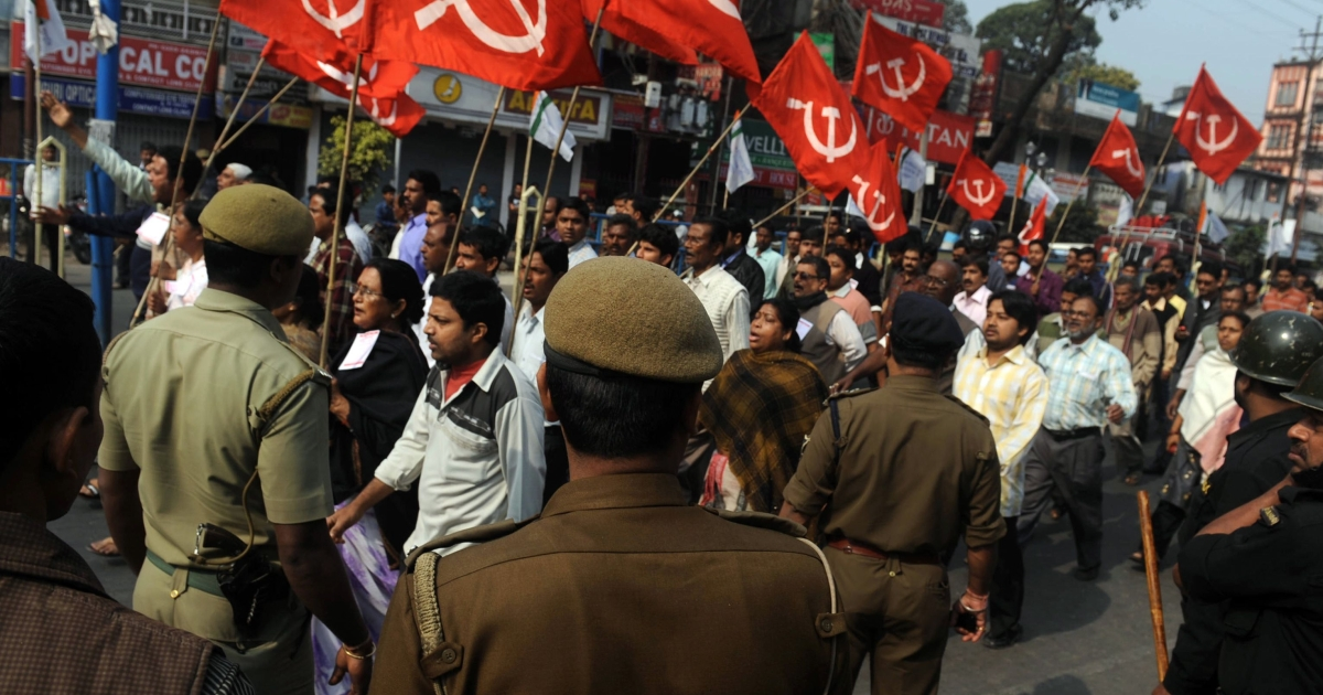 Members of trade unions and left-wing political parties participate in a protest rally in Siliguri as part of Tuesday's general strike.</p>