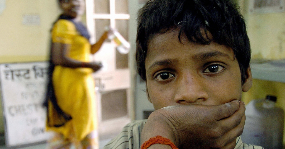 Indian tuberculosis patient Rampal waits to get his medicine at the L.N. J.P. hospital in New Delhi, 23 March 2004.</p>
