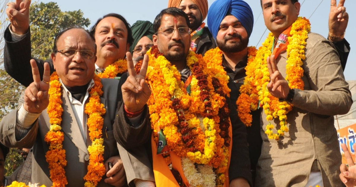 Victory for getting first as Asia's worst bureaucracy. Here, Bhartiya Janata Party (BJP) candidate for the Member of Legislative Assembly (MLA) Anil Joshi (C) poses with former Indian cricketer and Bharatiya Janata Party (BJP) member of parliament Navjot Singh Sidhu (2ndR) Bjp National Secretary and assistant in-charge Punjab Abhimanyu (R) show the 'V'sign as they go to file his nominations papers to Additional Deputy Commissioner Development office in Amritsar on Jan. 11, 2012. The state assembly elections are scheduled in five states and will be held on Jan. 30.</p>