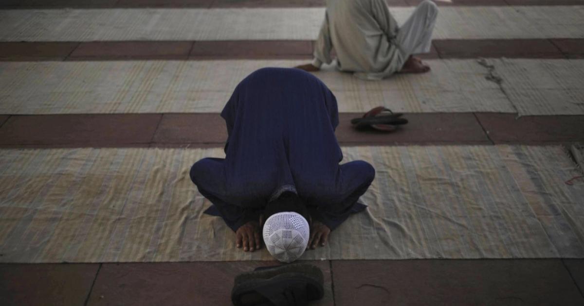 An Indian Muslim prays duringi the Friday prayer noon at the Jama Masjid in New Delhi.</p>