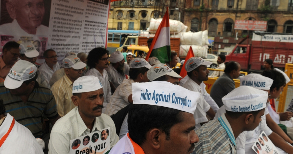 Followers of Indian social activist Anna Hazare wear caps to show their support for Hazare, after he was arrested, during a rally in Kolkata on August 16, 2011.</p>