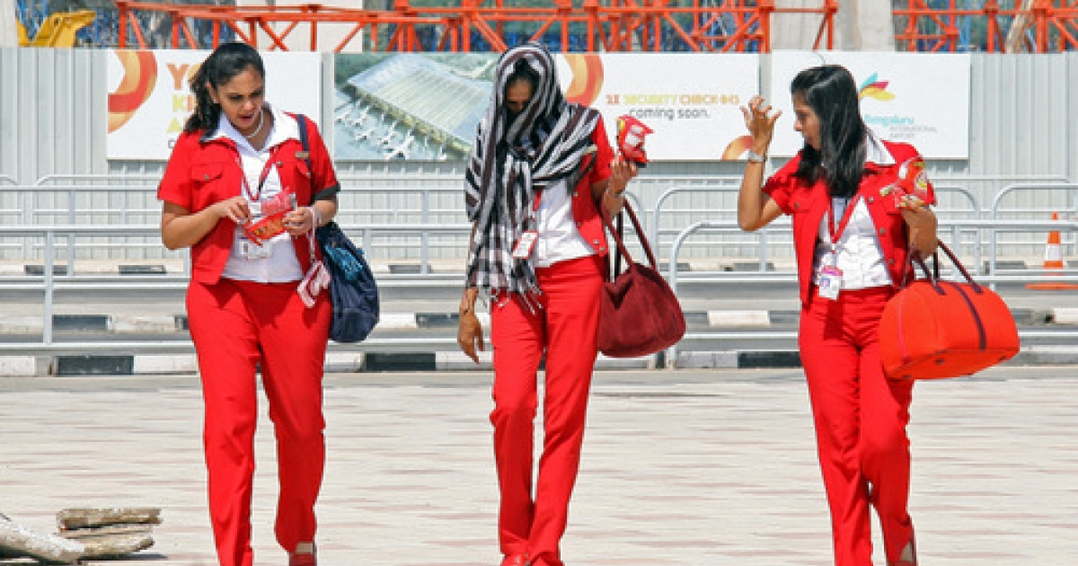 Kingfisher Airlines air hostess leave Bangalore International Airport on February 21, 2012 in Bangalore. India's Kingfisher Airlines was struggling to avoid closure as regulators ordered it to prove its operational viability after mass cancellations of flights.</p>