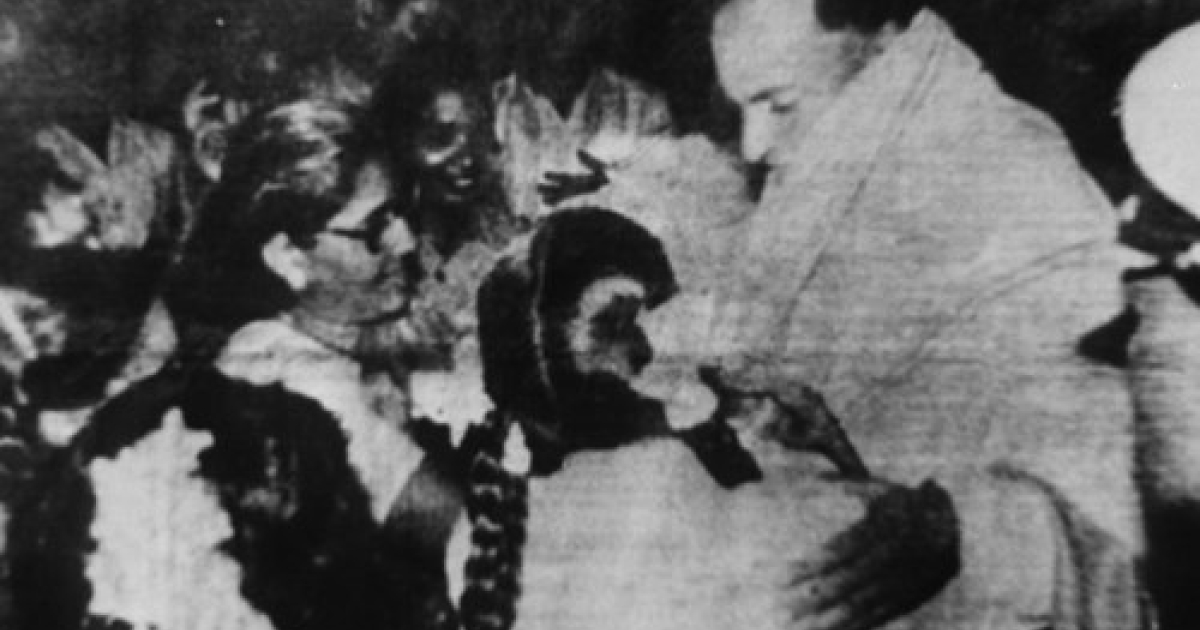 A May 21, 1991 file photo shows Rajiv Gandhi being greeted as he arrives to make an address during his election campaign moments before he was killed by a suicide bomber in Sriperumbudur, Tamil Nadu State. The suspected Tamil guerrilla assassin is in the bottom left corner with flowers on her head.</p>