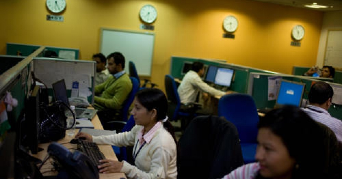 Indian staff work at a call-centre in Gurgaon on the outskirts of New Delhi on December 10, 2008. Described by author Palash Mehrotra as