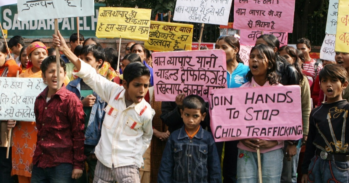 Indian children shout slogans during a protest in New Delhi on December 12, 2008 on the Global Day against Child Trafficking.</p>