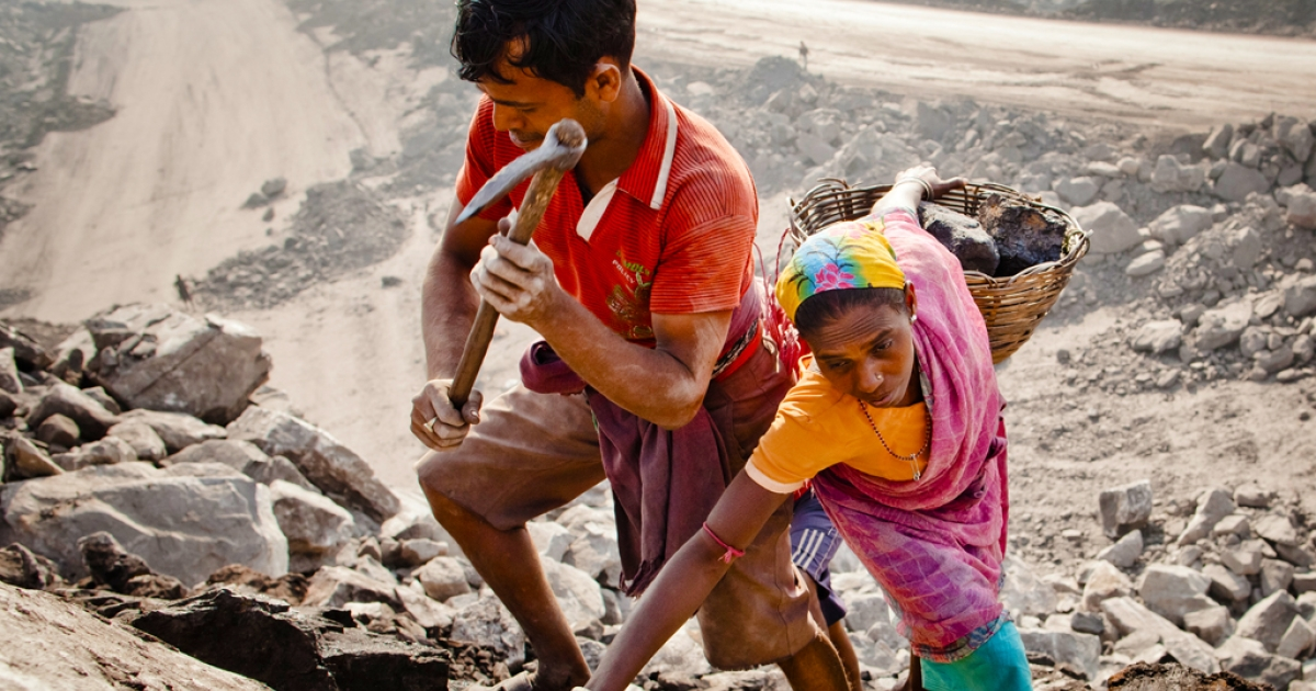 Local villagers work to scavenge coal illegally from an open-cast coal mine in the village of Jina Gora on February 11, 2012 near Jharia, India. Villagers in India's Eastern State of Jharkhand scavenge coal illegally from open-cast coal mines to earn a few dollars a day.</p>