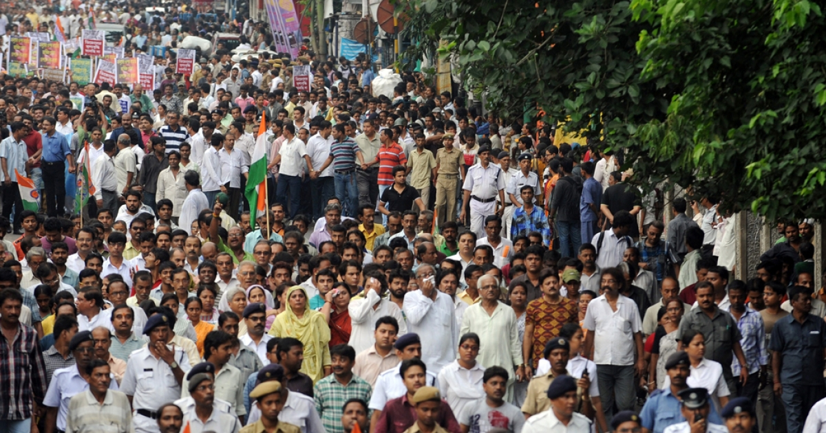 Indian activists of the Trinamool Congress (TMC) with the chief minister of the eastern Indian state of West Bengal Mamta Banerjee (unseen) march during a demonstration against the foreign direct investment (FDI) in multi-brand retail in Kolkata on September 15, 2012. The TMC pulled out of India's ruling coalition on September 18, 2012.</p>