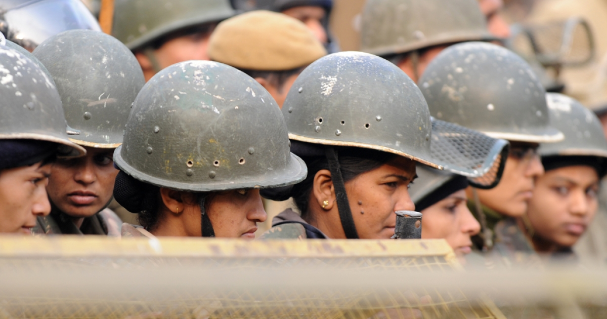 Indian policewomen stand alert behind a barricade during a protest calling for better safety for women following the rape of a student in the Indian capital, in New Delhi on December 27, 2012. Protests across India over the last week against sex crimes have denounced the police and government, with the largest in New Delhi at the weekend prompting officers to cordon off areas around government buildings. One policeman was killed and more than 100 people injured in the violence.</p>