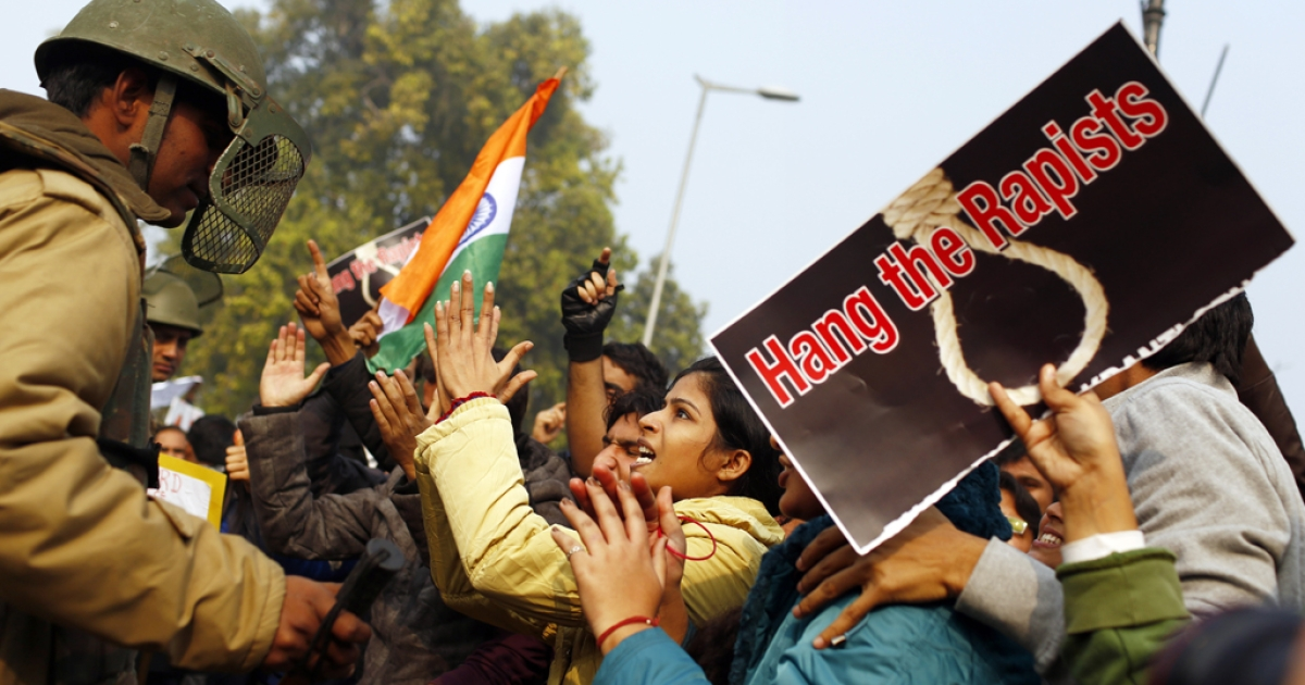 An Indian demonstrator taunts the police during a protest calling for tougher anti-rape laws on December 23, 2012, following the gang-rape of a student in Delhi days earlier. India is set to pass tough new legislation increasing the penalties for convicted rapists.</p>