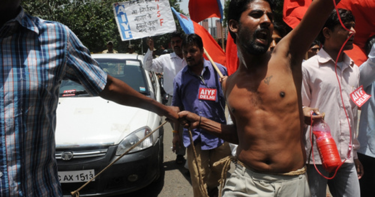 Members from the All India Youth Federation  (AIYF) and All India Students Federation (AISF) shout anti-government slogans and pull a rope tied to a car during a protest against petrol price hikes in New Delhi on May 25, 2012. Indian state-run oil firms announced the sharpest hike in petrol prices in nearly a decade to offset growing losses caused by subsidised rates, rises in the international oil price and a plunging rupee.</p>