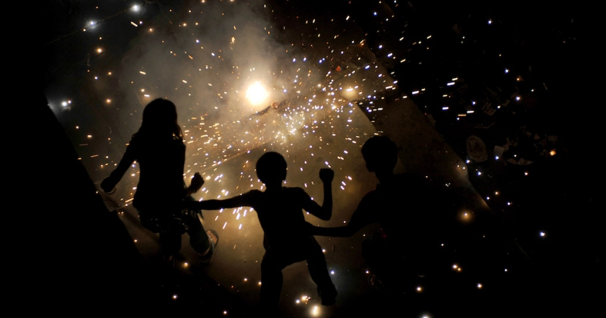 Indian children in New Delhi light fireworks for Diwali, the Hindu festival of lights, on October 26, 2011.</p>