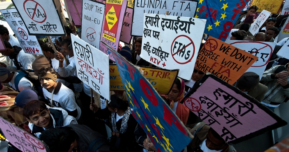 HIV and AIDS campaigners carry placards during a protest rally in New Delhi on February 10, 2012 against the negative impact of the EU-India Free Trade Agreement (FTA) on affordable medicines across developing countries.</p>