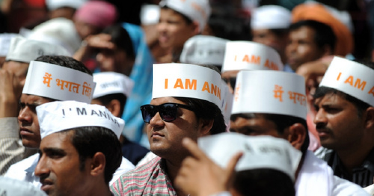Supporters of anti-corruption activist Anna Hazare gather during Hazare's day-long fast in New Delhi on March 25, 2012. Hazare has led a Joe McCarthy-esque attack on Prime Minister Manmohan Singh.</p>