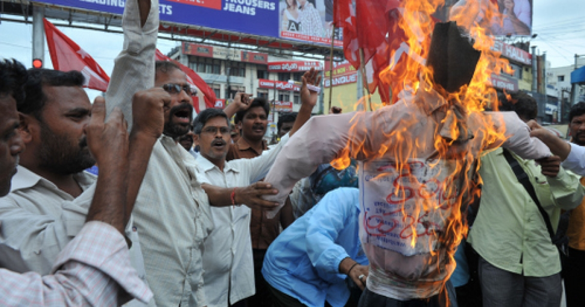 Members of the Communist Party of India, Marxists(CPI-M) burn an effigy of United Progressive Alliance (UPA) government during a protest against petrol price rises in Hyderabad on September 16, 2011. Rising oil costs have contributed to a spike in inflation that is becoming a major headache for India as the rupee plunges against the dollar.</p>