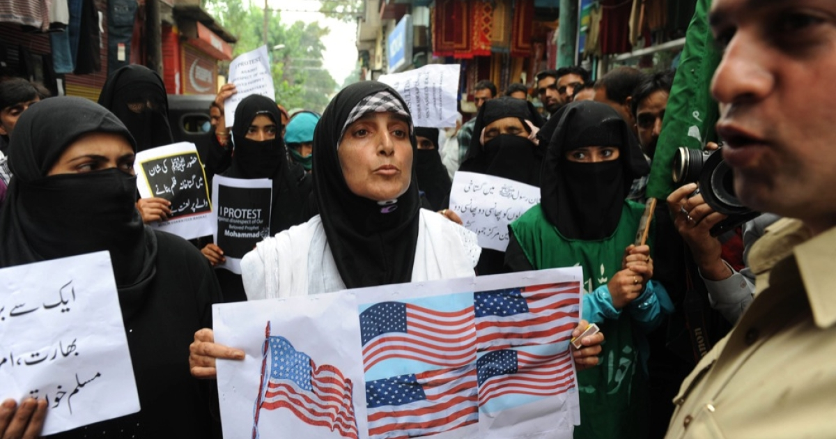 Indian chairperson from the separatist group Muslim Khawateen Markaz, Yasmeen Raja (C), and her supporters shout anti-US slogans during a protest against an anti-Islam movie in Srinagar on Sept. 17, 2012. A total of 17 people have died in violence linked to the film, including four Americans killed in Benghazi, 11 protesters who died as police battled to defend US missions from mobs in Egypt, Lebanon, Sudan, Tunisia and Yemen, and the two US soldiers in Afghanistan.</p>