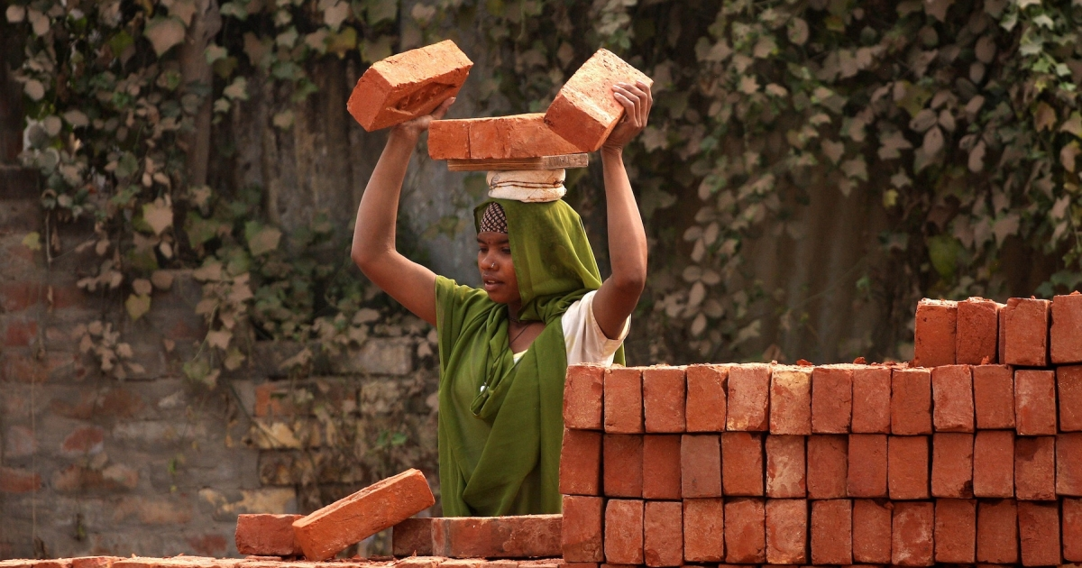 A young Indian labourer carries a load of bricks as she works on a construction site in Allahabad on November 16, 2012. According to a new study, India will become the world's second-most competitive country in the brick-and-mortar manufacturing sector over the next five years.</p>