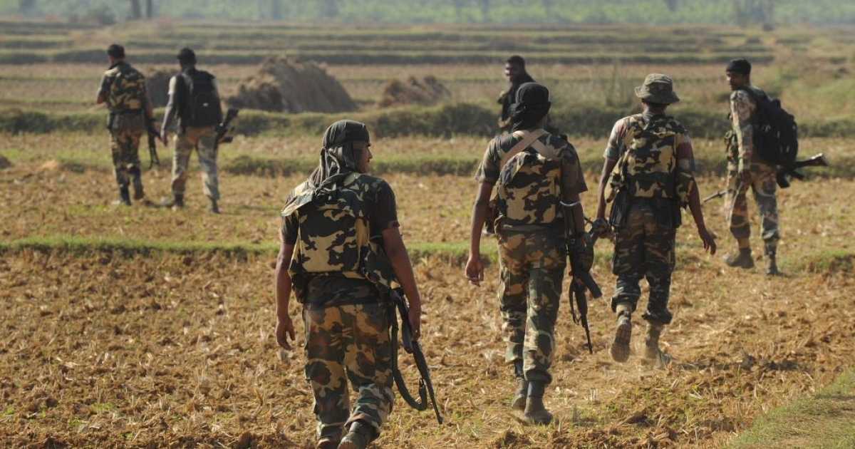 File Photo -- Indian paramilitary force search for Maoist rebels in Nov. 2011 near Burisole, south-west of Kolkata.</p>