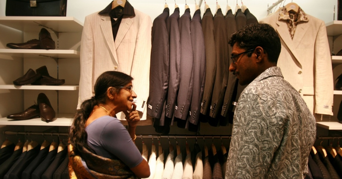 Locals shop on April 14, 2008 in Bangalore, India. India's new middle class is more than 300 million, and growing.</p>