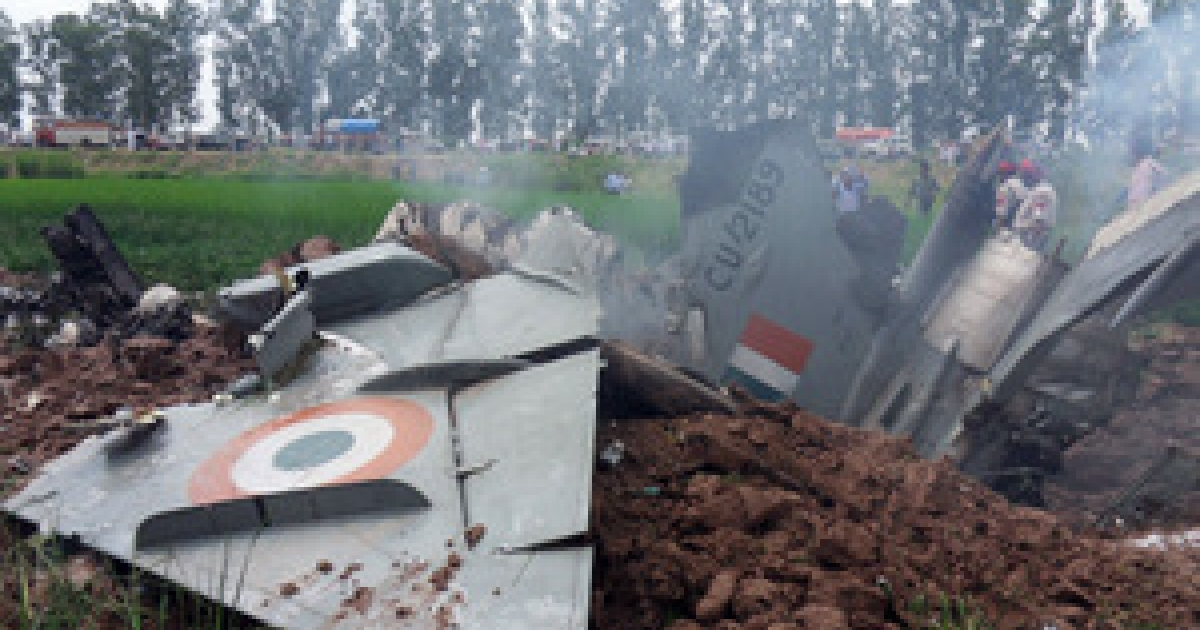 Indian Air Force personnel stand by the wreckage of a MiG-21 aircraft that crashed in a field in Rajgarh, in Patiala district on September 6, 2011. An Indian air force MiG-21 fighter jet crashed in the northern state of Punjab, the pilot ejected safely, causing no casualties. The Russian-designed jet came down near the town of Rajpura, some 30 kms from Patiala.</p>