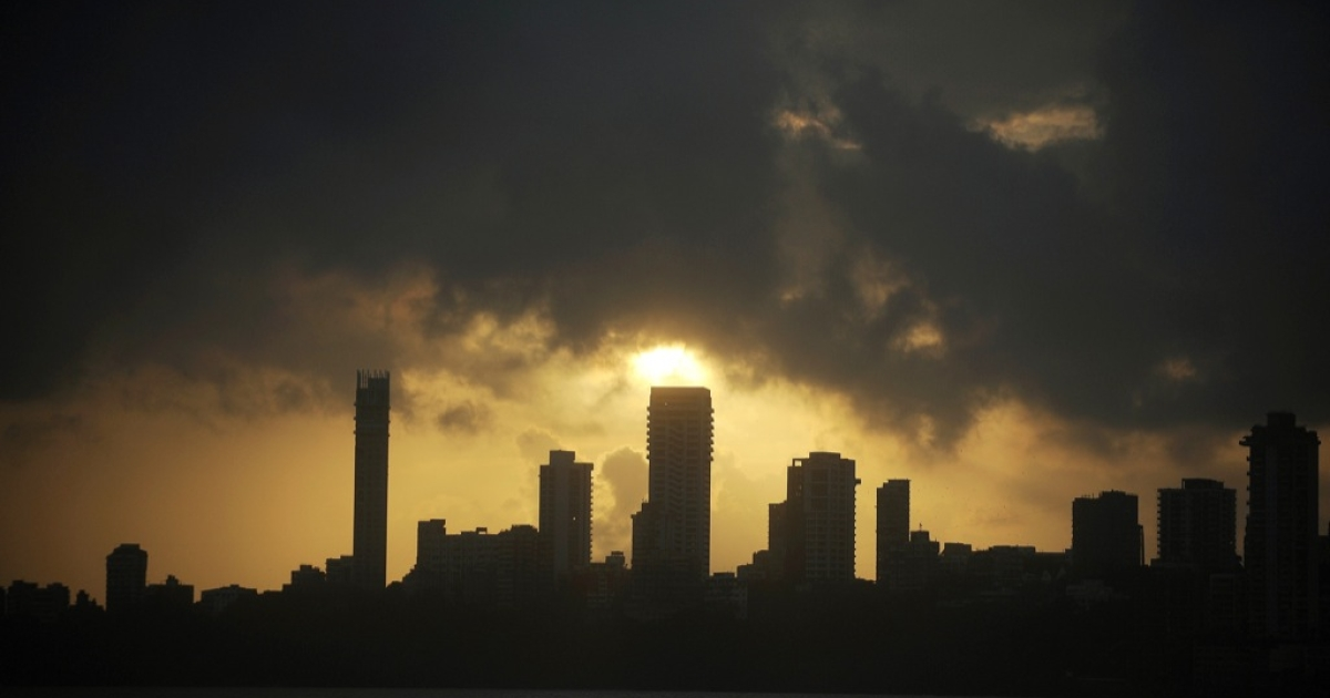 The sun sets over the skyline of Mumbai on September 7, 2012. Media outlets have recently reported an increase of legal outsourcing to India.</p>