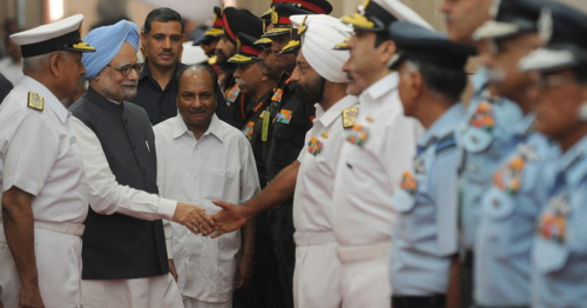 Indian Prime MInister Manmohan Singh (2L) shakes hands with the commanders of the Indian armed forces as Indian Defence Minister A. K. Anthony (3L) looks on during the inauguration of a five day long Annual Combined Commanders conference in New Delhi on October 11, 2011.</p>