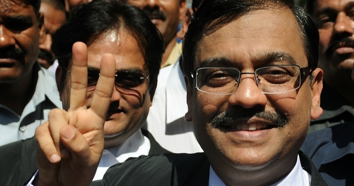 India's court backlog is not looking so victorious. Here, however, special public prosecutor Ujjwal Nikam flashes a victory sign after speaking with media outside the high court in Mumbai on February 21, 2011. Two Indian judges rejected the appeal of the sole surviving gunman from the 2008 Mumbai attacks against his conviction and death sentence. The judges at the Bombay High Court dismissed the appeal by Pakistani national Mohammed Ajmal Amir Kasab over his role in the attacks that killed 166 and injured more than 300 people.</p>