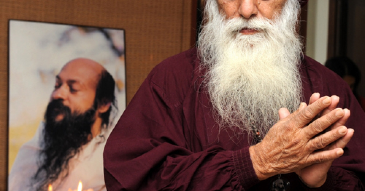 Osho follower Swami Anand Ghan gestures as a meditation service takes place in Ahmedabad on February 16, 2010, in memory of those killed in a bomb attack at a German bakery near the Osho commune in Pune, Maharashtra.</p>