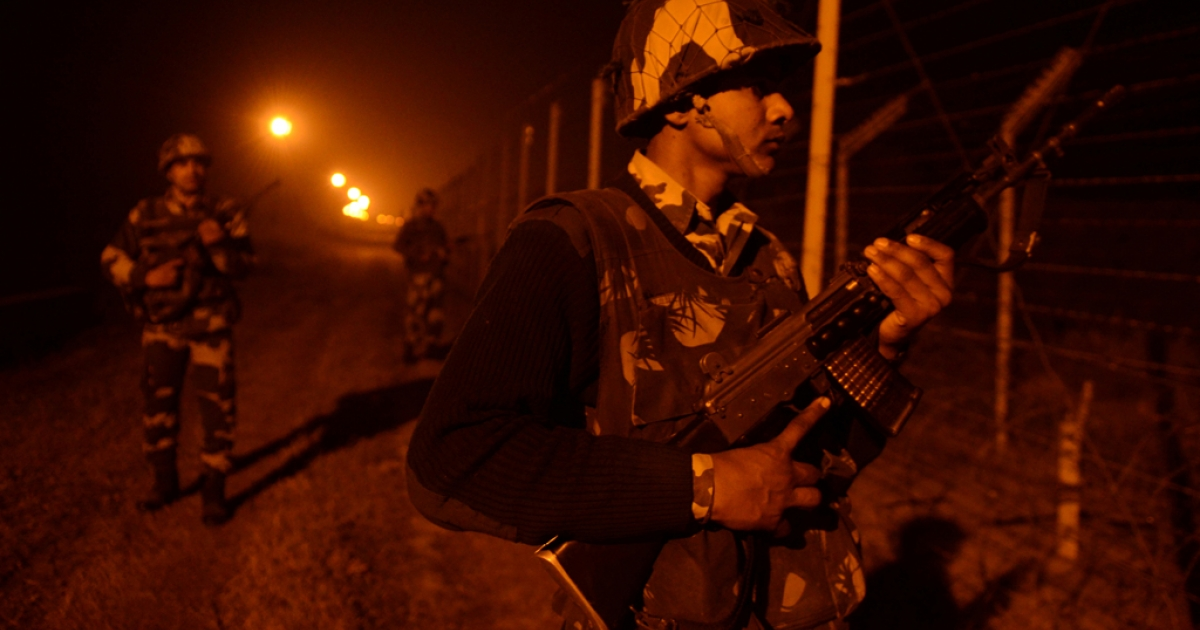 An Indian Border Security Force (BSF) soldiers patrol along the border fence at an outpost along the India-Pakistan border in Suchit-Garh, 36 kms southwest of Jammu on January 11, 2013. Pakistan summoned the Indian ambassador to protest against