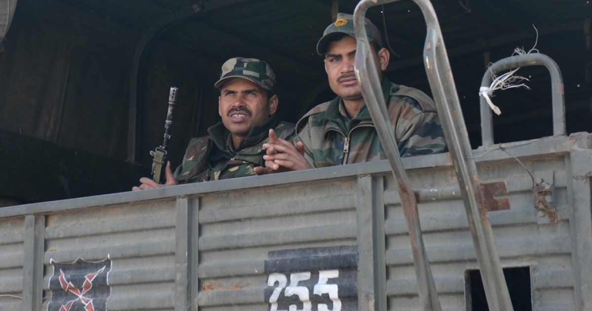Indian soldiers ride in a military truck as they move towards a camp in Jammu on January 10, 2013.  The beheading of an Indian soldier may have sparked a war of words between Delhi and Islamabad but the two nuclear rivals are both determined to prevent it from wrecking a fragile peace process.  Two Indian soldiers died after a firefight erupted in disputed Kashmir on Tuesday as a patrol moving in fog discovered Pakistani troops about 500 metres (yards) inside Indian territory, according to the Indian army.</p>