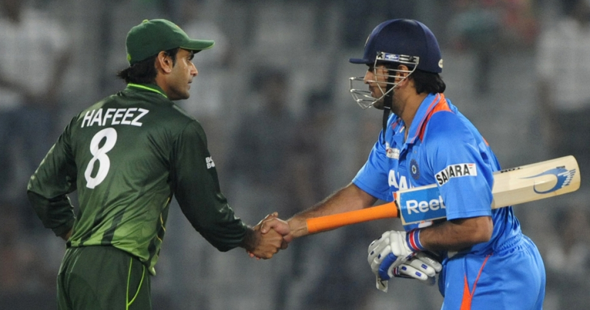 Indian captain Mahendra Singh Dhoni (R) shakes hands with Pakistan's Mohammad Hafeez (R) after India won the one day international (ODI) Asia Cup cricket match against Pakistan at The Sher-e-Bangla National Cricket Stadium in Dhaka on March 18, 2012. The two countries are likely to resume bilateral cricket ties once the Board of Control for Cricket in India's plan to invite Pakistan for a series goes forward.</p>
