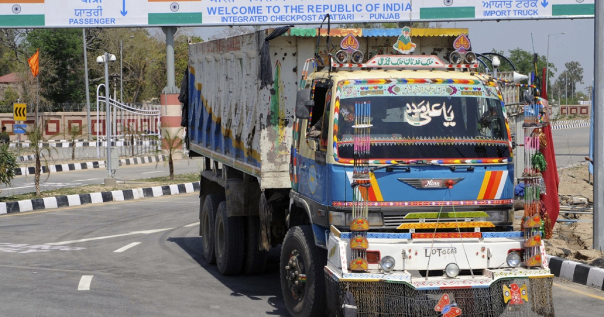 A Pakistani truck, pictured after transporting a shipment of goods, drives through the newly-constructed Integrated Checkpost (ICP) at the India-Pakistan border in Wagah on April 12, 2012. India has also agreed to allow foreign direct investment from Pakistan as of April 13, 2012.</p>