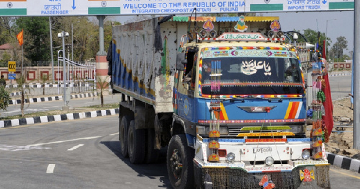 A Pakistani truck, pictured after transporting a shipment of goods, drives through the newly-constructed Integrated Checkpost (ICP) at the India-Pakistan border in Wagah on April 12,2012. The first integrated checkpost (ICP) at the Indo-Pakistani Wagah border will be inaugurated by Indian Home Minister P. Chidambaram on April 13, with aims of boosting trade ties between India and Pakistan.</p>